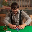 Poker player enjoys winning. — Foto de Stock