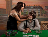 Wife persuades her husband to stop playing poker. — Stock Photo