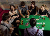 Young playing poker. — Stock Photo