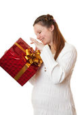 Happy pregnant girl with gift. — Stock Photo