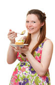Beautiful pregnant girl with cake. — Stock Photo