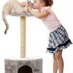 Little girl kisses her cat. — Stock Photo #5304912