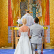 He and she in a church — Stock Photo