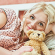 Beautiful young girl with toy - Stock Photo
