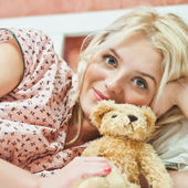 Beautiful young girl with toy — Stock Photo