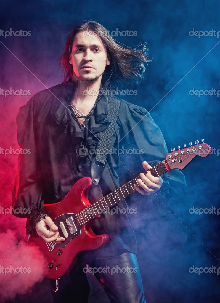 Rock-star perfoming loud music on red electric guitar — Stock Photo #4381884