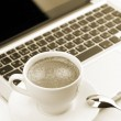Royalty-Free Stock Photo: Cappuccino cup on laptop