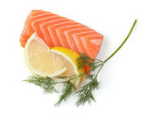 Fresh salmon steak with lemon slices and dill — Stock Photo