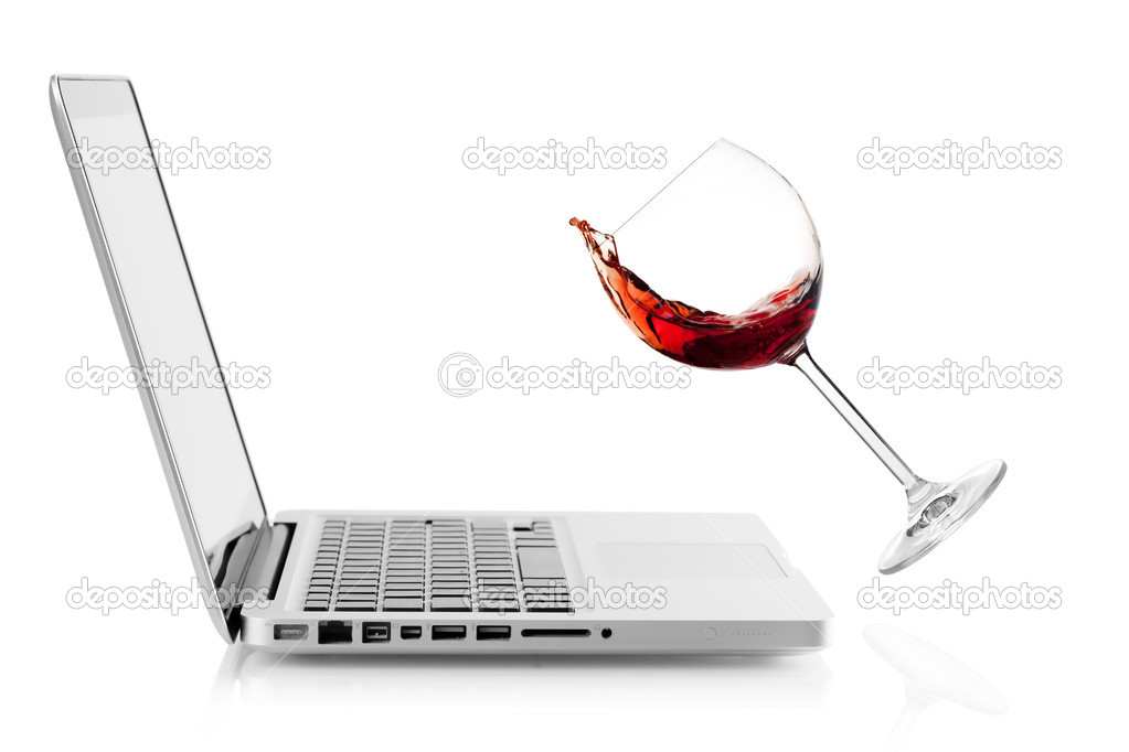 Wine falling on laptop. Isolated on white background — Stock Photo #4382150