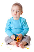Small baby holding yellow flower — Stock Photo