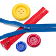 Three colored sewing buttons and two zippers — Stock Photo
