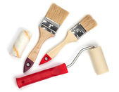Two paintbrushes and roller — Stock Photo