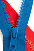 Blue and red zippers closeup — Stock Photo
