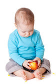 Small baby holding red apple — Stock Photo