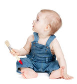 Small baby worker with paint brush — Stock Photo
