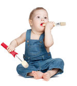 Small baby worker with paint brush and roller — Stock Photo