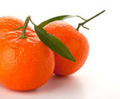 Ripe tangerines with green leaf — Stock Photo
