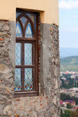 The antique window in old stone wall — Stockfoto