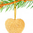 Christmas heart bauble on a pine branch isolated on white — Stock Photo