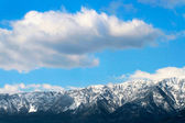 Winter mountains below blue cloudy sky — Stok fotoğraf