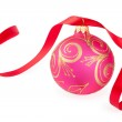 Christmas ball with a red ribbon isolated on white — Stock Photo