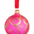 Pink Christmas bauble on a ribbon against white background — Stock Photo