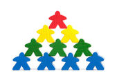 Wooden figures symbolizing difference or team work — Stock Photo
