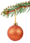 Golden bauble on a Christmas tree branch — Stock Photo