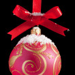 Red Christmas ball on a ribbon against black background — Stock Photo #4628689