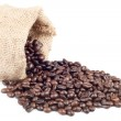 Coffee beans in canvas sack on white background — Stock Photo #4628787