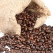 Coffee beans in canvas sack on white background — Stock Photo #4628804