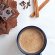 Stock Photo: Cup of hot cacao with chocolate bar, cinnamon and cloves