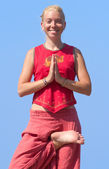 Beautiful girl making yoga exercise — Stock Photo
