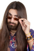 Long-haired hippie man with the glasses — Stock Photo