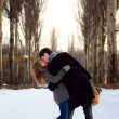 Young couple kissing in the poplar alley - Stock Photo