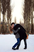 Young couple kissing in the poplar alley — Stock Photo