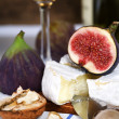 Cheese, figs and white wine — Stock Photo #4055626