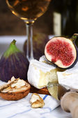 Cheese, figs and white wine — Stock Photo