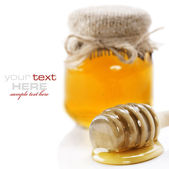 Honey over white — Stock Photo
