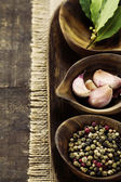 Wooden bowls with fresh herbs and spices — Stock Photo