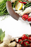Open notebook and fresh vegetables — Stock Photo