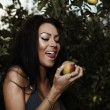 Sexual beauty dressed bikini poses in an autumn garden of apples. - Stock Photo