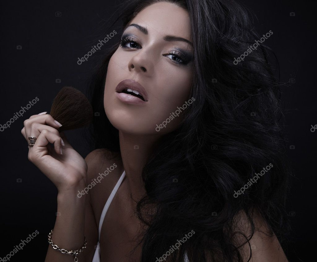 Portrait of attractive young adult woman applying blusher — Stock Photo #4071498