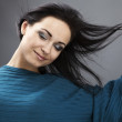 Young woman in a turquoise sweater. Studio close-up fashion portrait. — Stock Photo