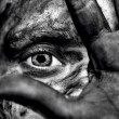 Surreal dark portrait of someone whos covering his dirty face. - Stock Photo