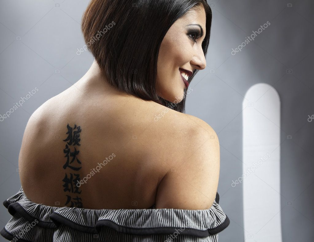 pretty girl with tattoo on