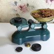 Old scales with delicacies - Stock Photo