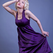 Young teen woman wearing a purple dress - Lizenzfreies Foto