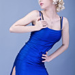Portrait of young blonde girl in blue fashion dress. - Lizenzfreies Foto