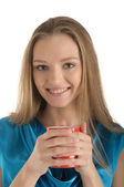 Woman with brackets on teeth and cup — Stock Photo